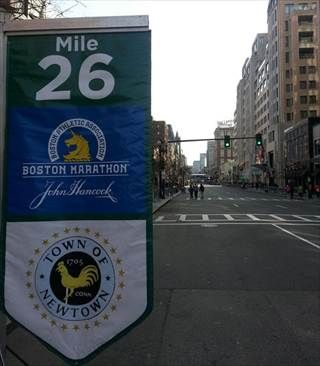 Banner at mile 26 of the Boston marathon commemorating the dead children of Sandy Hook