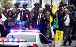 Slave Nation: Civilian employees at the Washington Navy Yard are frog-marched out of a building with their hands up following the mass shooting in Washington, D.C. on September 16, 2013