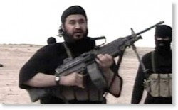 Abu-Musab-bin-taking-kickbacks-from-the-CIA-Zarqawi, in a desert somewhere...with a gun.